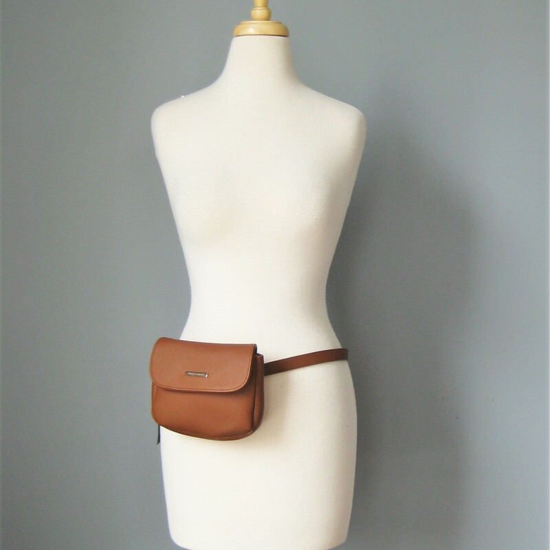 NWT Vince Cumato Fanny, Brown, Size: None Brand new belt bag from Vince Camuto This bag with fit in most belt loops so it's going to be your belt and your Bag. The support from your pants' belt loops will make this so much more comfortable to use. Size XL the bag part is 8in x 6in x 1in magnetic snap closure. Thanks for looking! #37918
