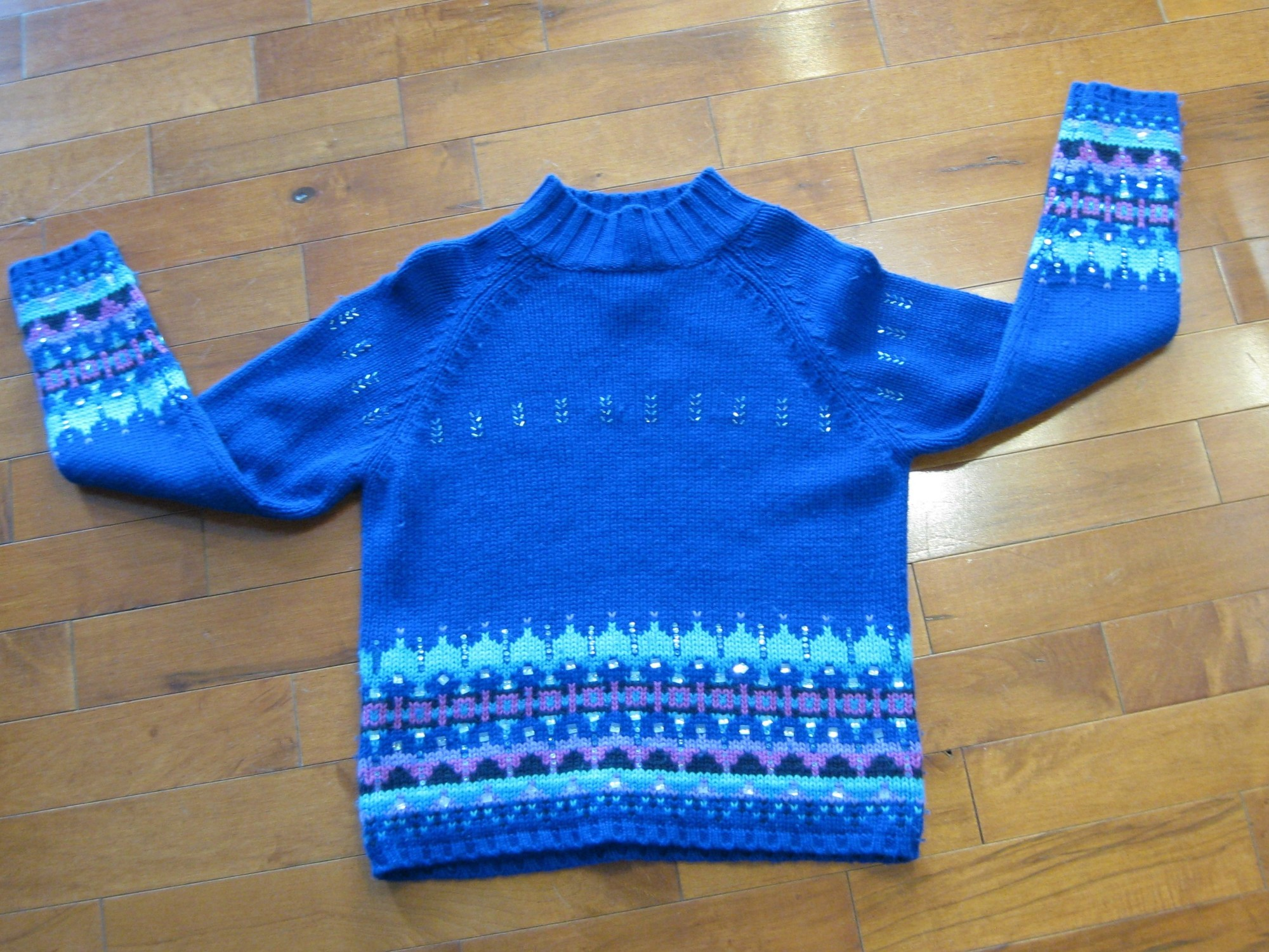 Acrylic and lambswool blend ski sweater by St. John's Bay from the 1980s<br /> So cute in royal blue with touches of lavender and a sprinkling of bugle beads<br /> small section of missing beads as shown<br /> Marked size medium petite<br /> flat measurements:<br /> armpit to armpit: 18.75in<br /> length: 20in<br /> <br /> made in Hong Kong<br /> <br /> thanks for looking!<br /> #39252