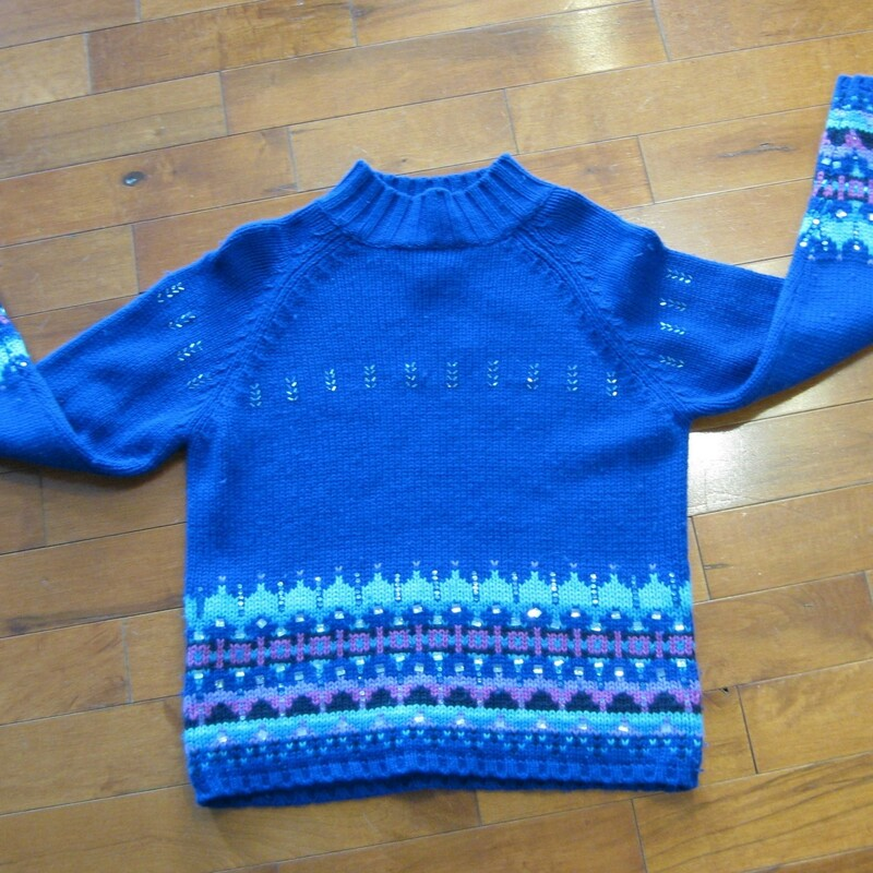 Acrylic and lambswool blend ski sweater by St. John's Bay from the 1980s So cute in royal blue with touches of lavender and a sprinkling of bugle beads small section of missing beads as shown Marked size medium petite flat measurements: armpit to armpit: 18.75in length: 20in  made in Hong Kong  thanks for looking! #39252