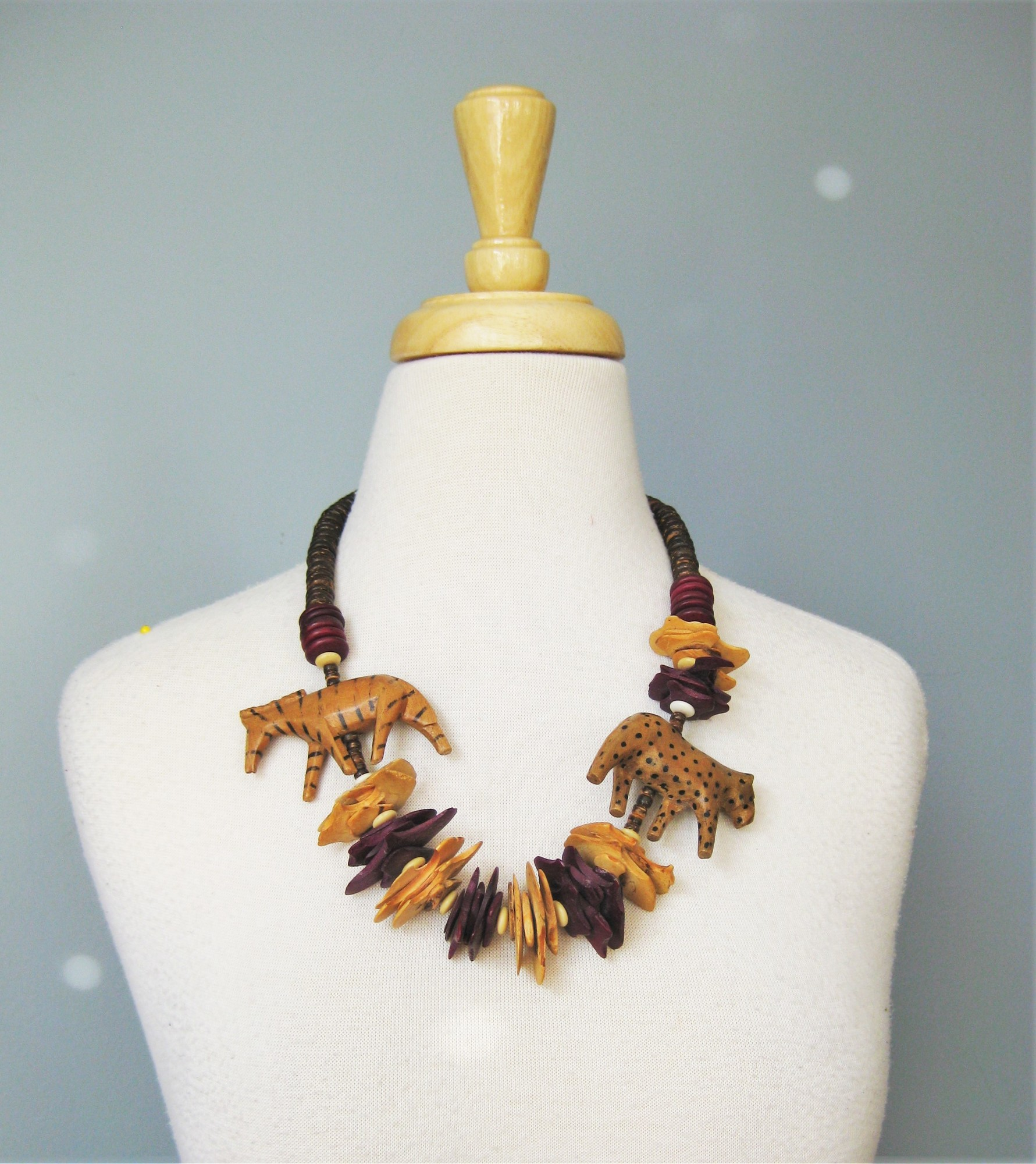 Wooden Animal, Brown, Size: None<br /> Two wild animals patrol this wooden necklace.  The cheetah doesn't know about the zebra and the zebra is wisely moving in the other direction!  Wine red , tan and dark brown beads and disks in wood make up this charming conversation piece.<br /> <br /> 24in in length<br /> <br /> Screw closure<br /> <br /> <br /> thanks for looking!<br /> #40100