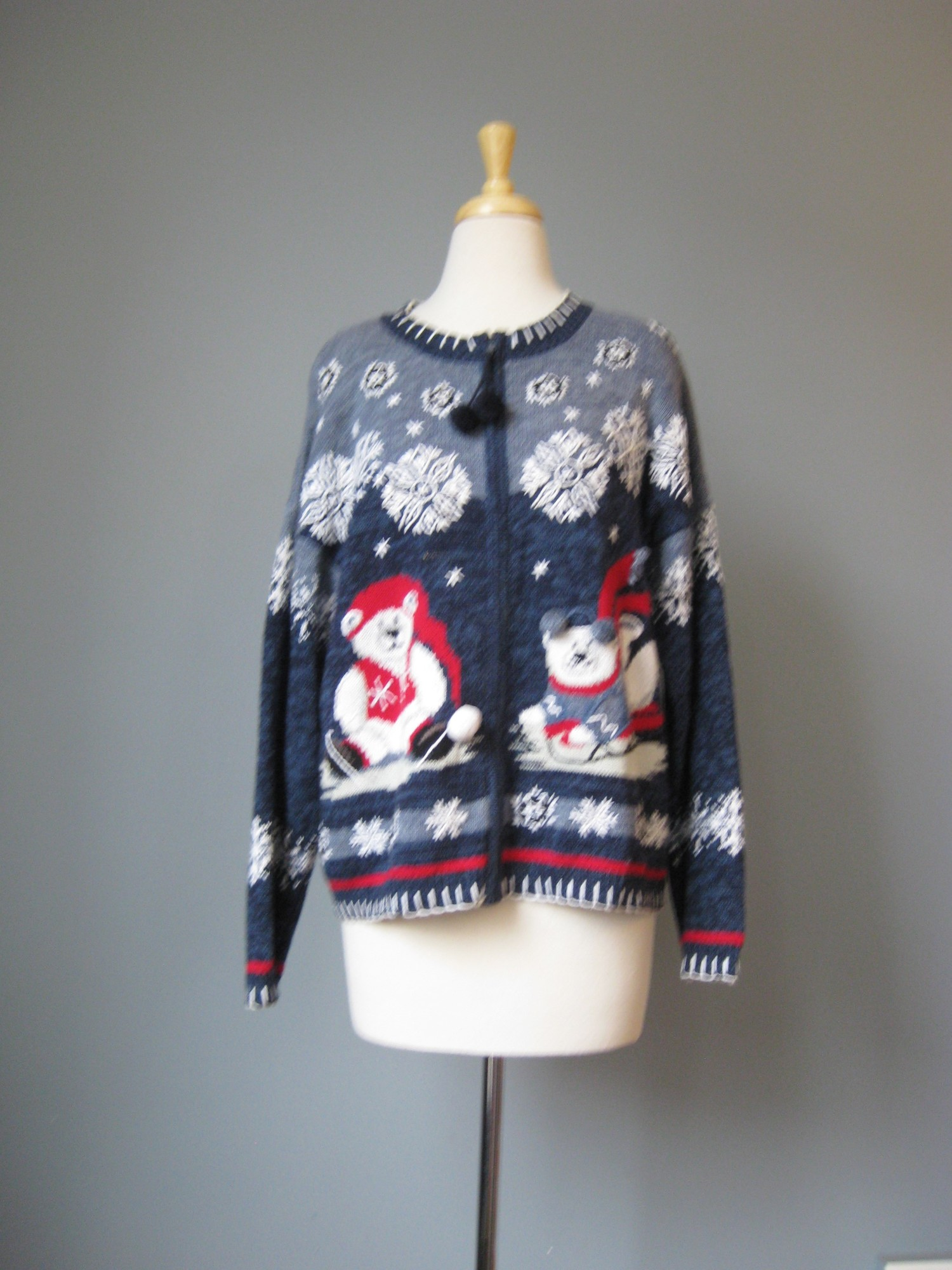 FB XMAS Zip Up, Blue, Size: L<br /> Here's a perfect gift for the Polar Bear Lover in your life.<br /> Cute (not ugly!) Christmas Cardigan Sweater in blue with sporty  polar bears skiing and skating across the lower front.<br /> I love the pom poms on the bears and the zipper pull<br /> Size XL<br /> Ramie Cotton Blend<br />  armpit to armpit: 23in<br /> length: 25.25in<br /> Cotton Ramie Blend<br /> thanks for looking!<br /> <br /> #40197