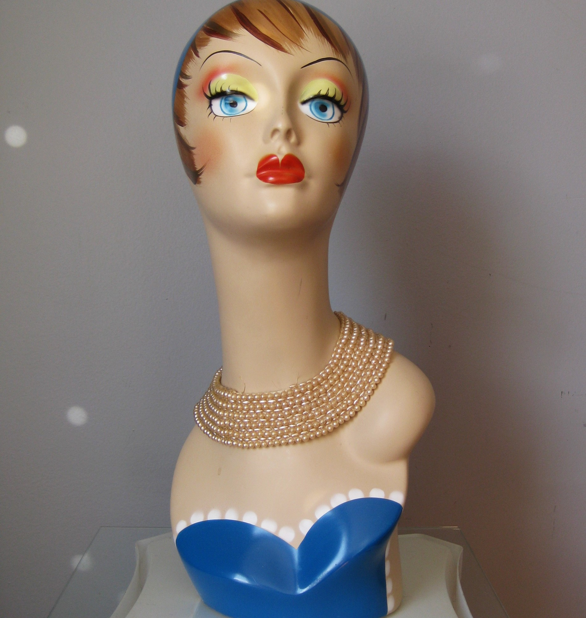 Vintage pearl collar from the 1940s or maybe 1950s.<br /> Wear over a plain top or as choker necklace.<br /> Faux pearls, satin backing.<br /> single hook and eye closure<br /> Great condition, the center of the top row of the longer narrow shaped pearls are missing but the pearls are sewn on in such a way that there won't be any further unraveling.  Some of the pearls have a bit of the finish rubbd off as well.<br /> Please see all the photos.<br /> Length: 15.75in<br /> <br /> Thanks for looking!<br /> #560