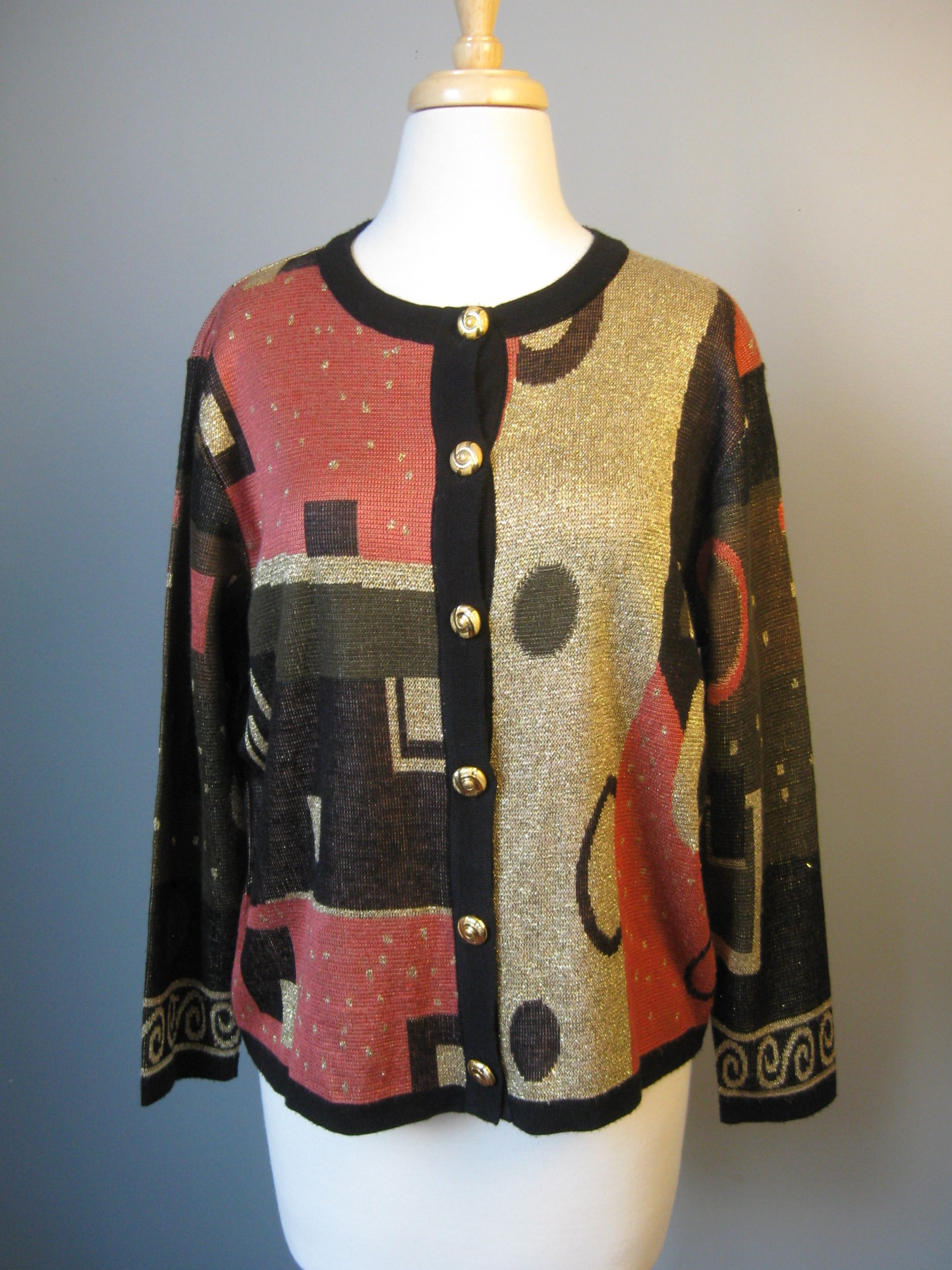 Subtly shimmery cardigan with gold metal buttons and abstract cubist pattern<br /> 100% acrylic<br /> Should fit medium to large<br /> armpit to armpit: 21in<br /> length: 20 1/2in<br /> <br /> excellent pre-owned condition<br /> thanks for looking!<br /> #6202