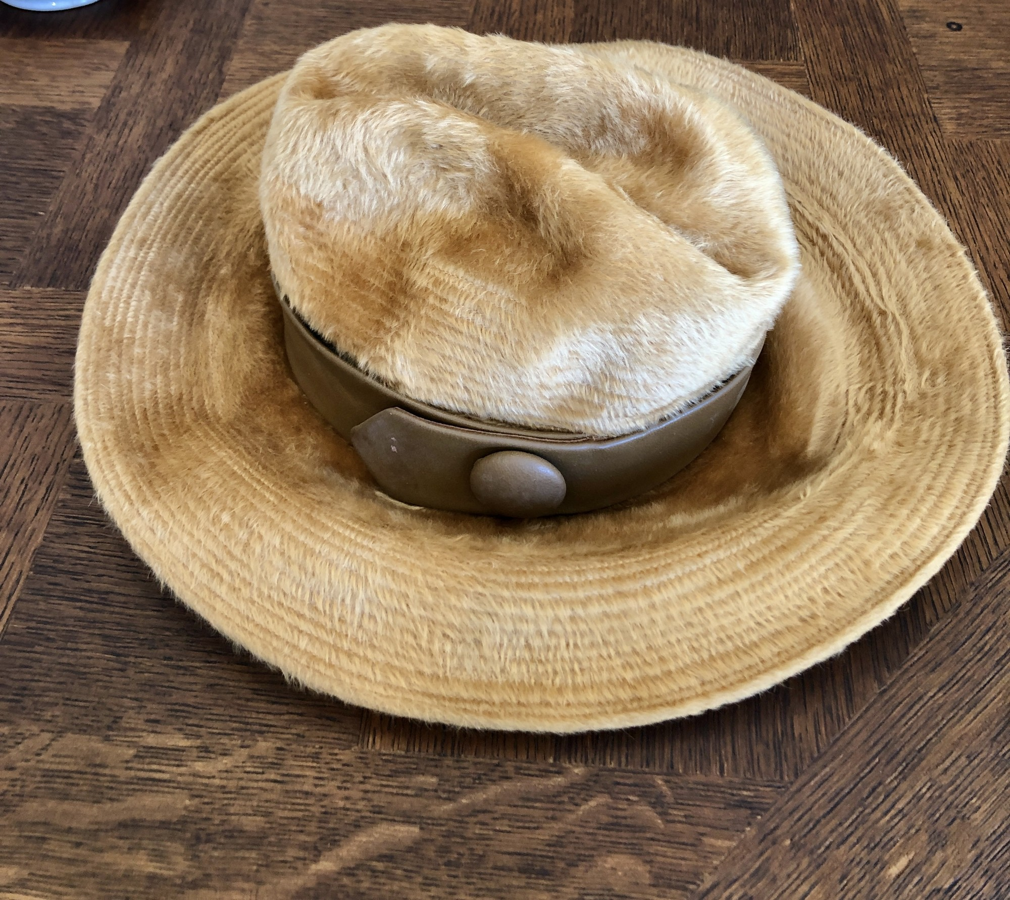 """Fabulous vintage CHRISTIAN DIOR Felt Wool hat with leather band c. 1950, It's a pretty neutral camel color. Inside diameter is 7.25\"""" front to back and 6.5\"""" side to side. Brim to brim is 14\"""".<br /> Will ship USPS Priority mail."""