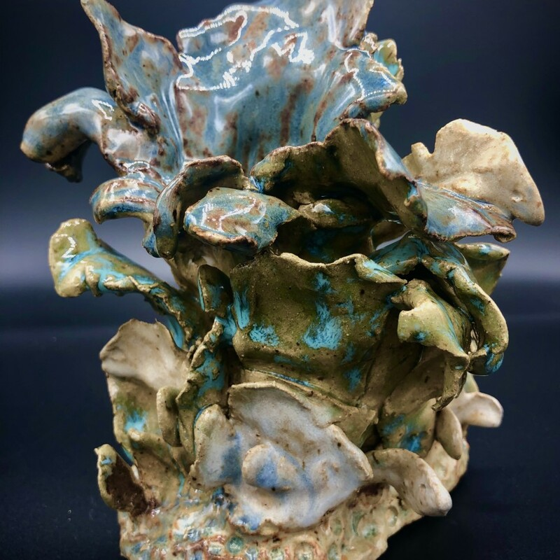 """Title: Ocean Lily Artist: David Gwaltney Size:7x5x5\"""" Medium: Clay Statement: Coral Reef Series,  Brown and White Clay hand built sculpture, Various glazes. Fffired Cone 6"""