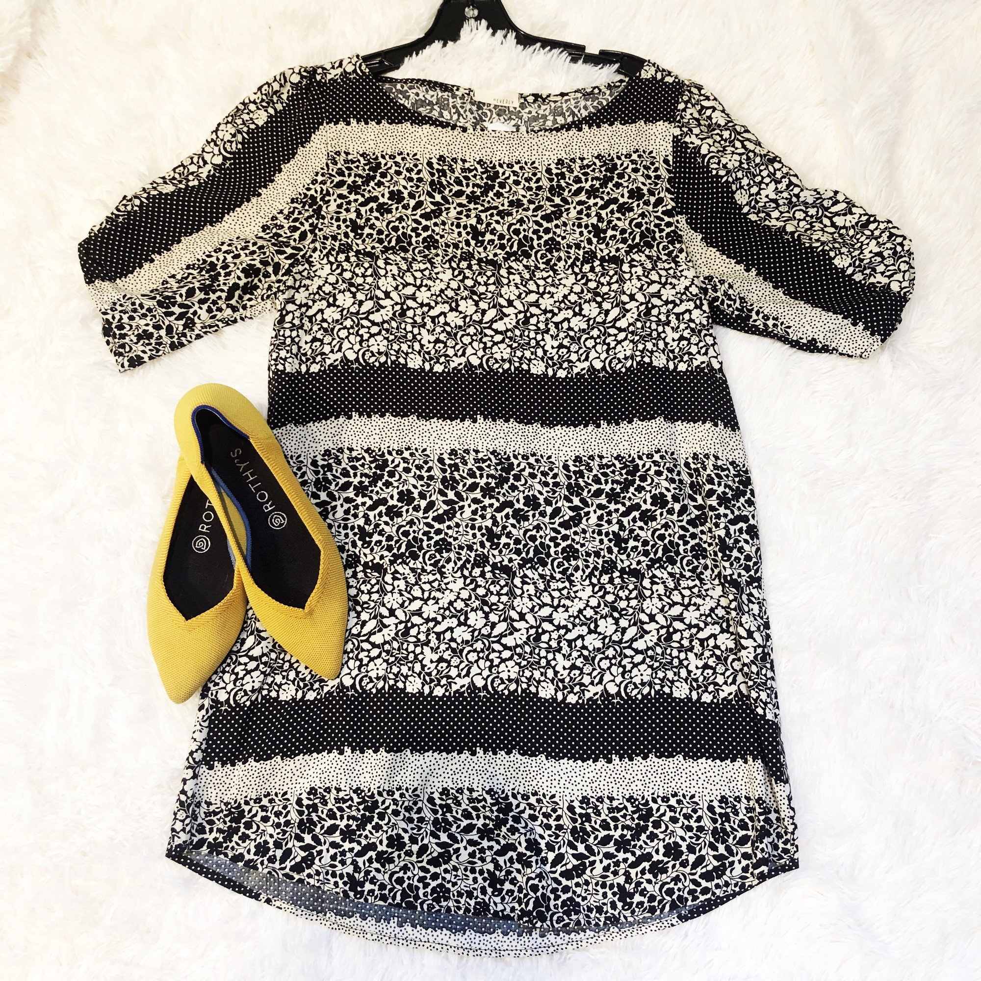 We love the buttons on the sleeve and the fun different black and cream flower patterns