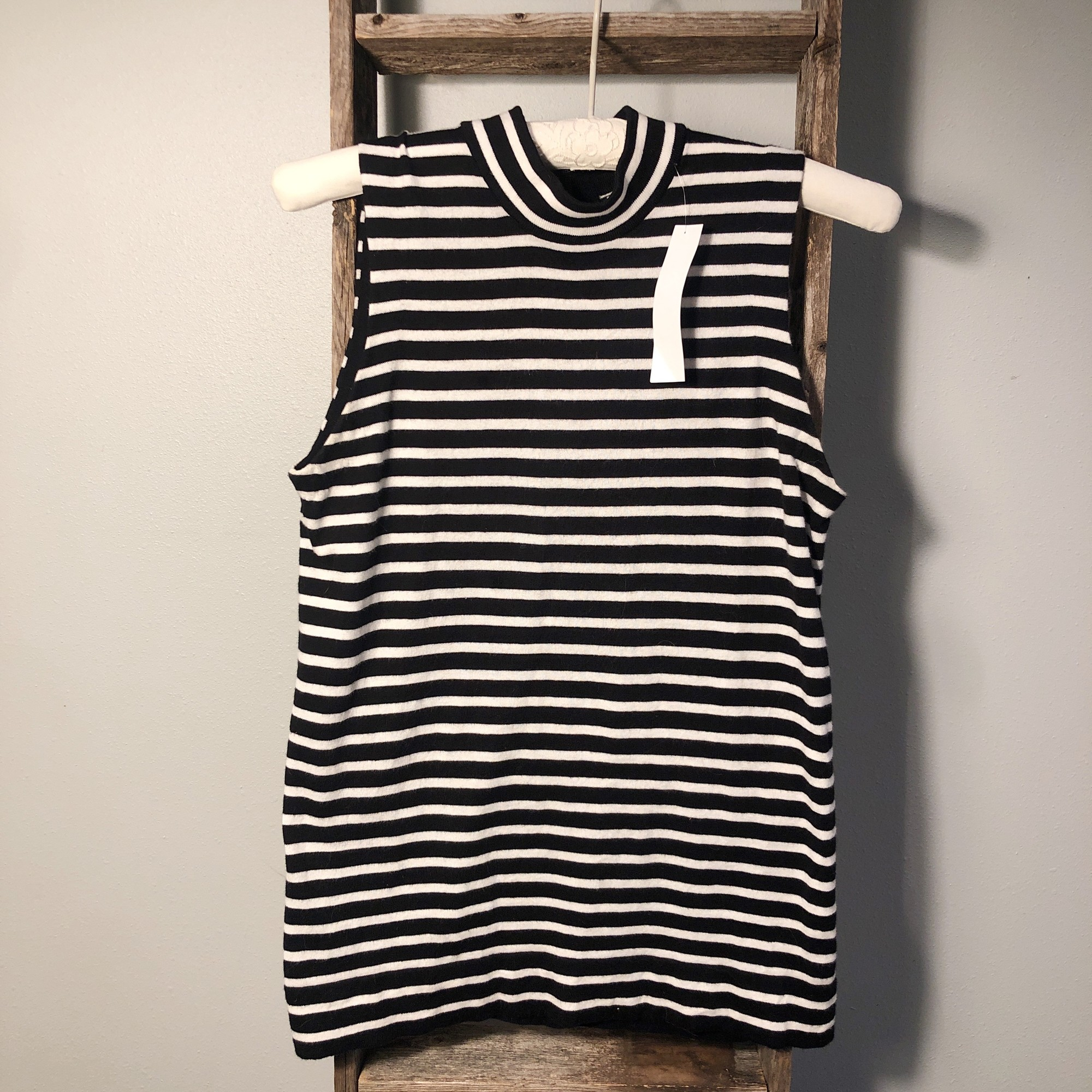 Perfect for layering a sweater over and  adorable zippered neck at the back