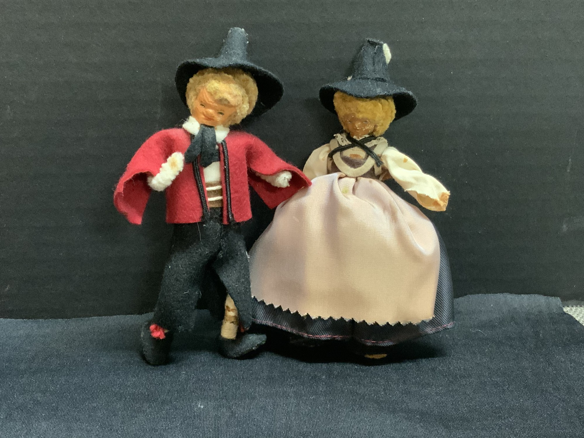 This is a set of two five inches tall pipe cleaner dolls. In fragile shape but oh so charming.