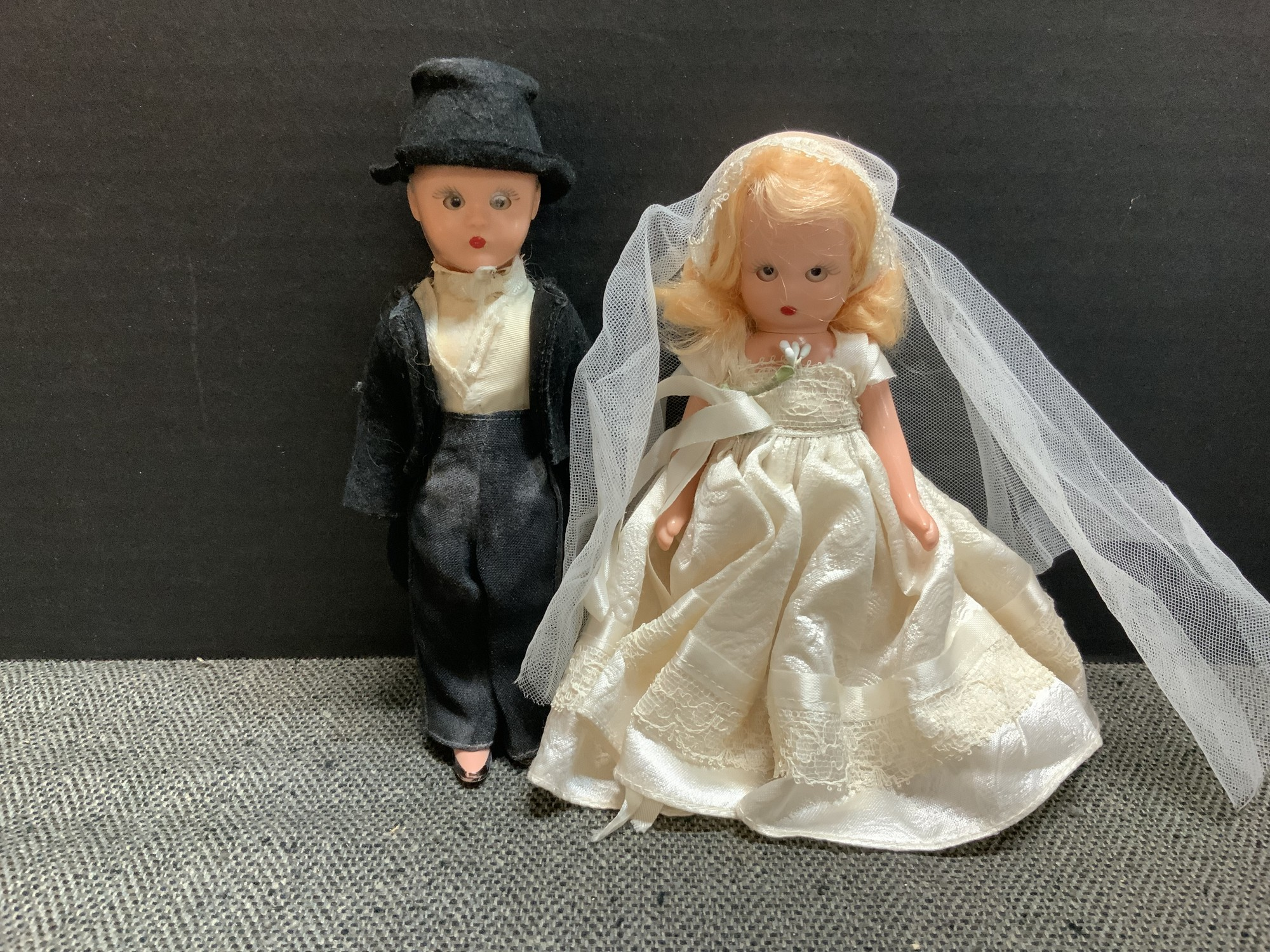 This darling Mary Ann Storybook Doll Couple is ready to be displayed. Both are six inches tall and are complete with stand. In nice condition considering their age.