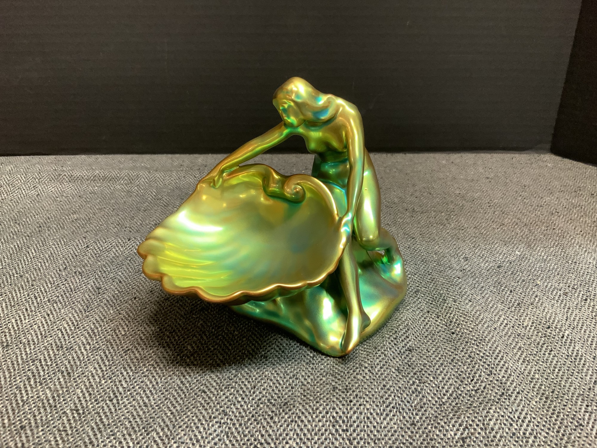 Roughly 5 inches wide by 5.5 inches tall; this piece shimmers beautifully in the light with hints of copper and aqua over its emerald surface.