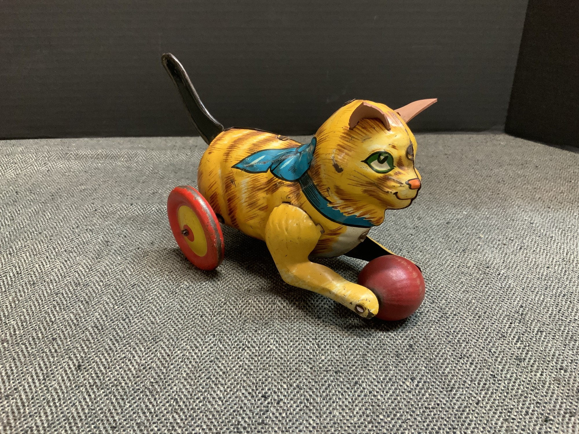 This toy measures 9 inches at its widest and 5 inches at its tallest. It still maintains vibrant colors and is in good condition for its age.