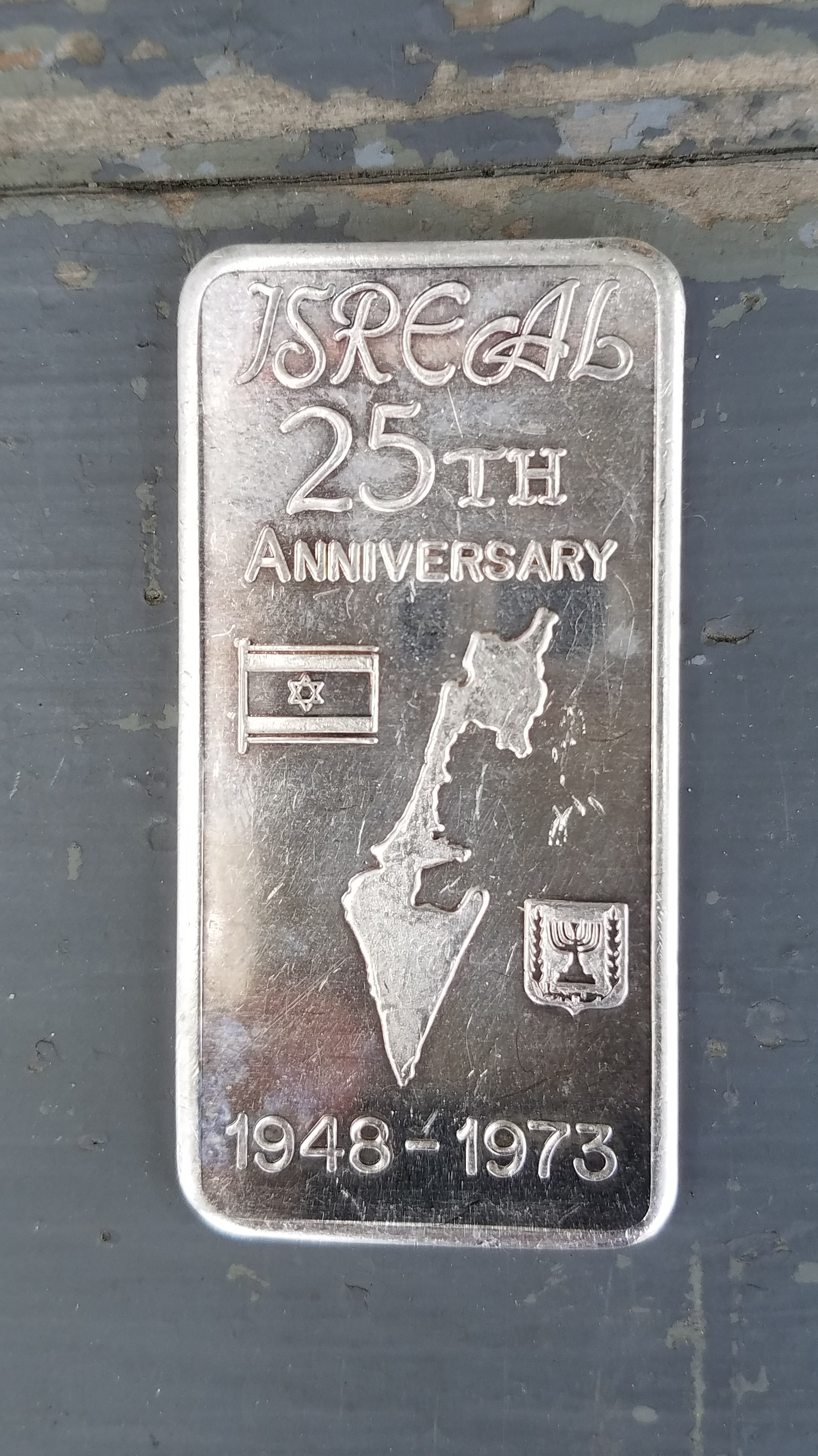 VINTAGE SILVER<br /> ONE TROY OUNCE<br /> .999 FINE SILVER<br /> ISREAL 25TH ANNIVERSARY<br /> 1948 - 1975