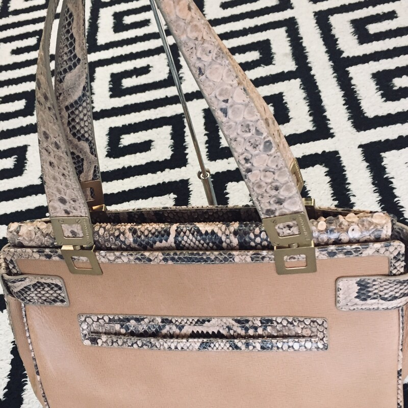 Suen Cooper shoulder bag is made of alligator on exterior and the interior is lined in leather. Gold hardware on the straps. Does have a few exterior scratches, but still has lots of love to give! Retail: $4000 Such a steal!!!